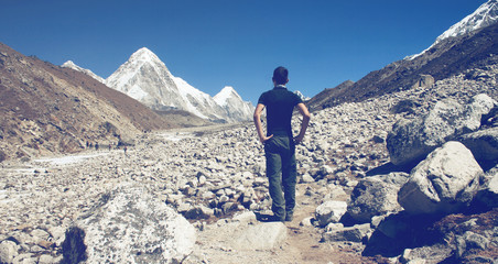 Man standing surveying a glacier in Nepal