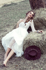 Fashion male model lying on haystack