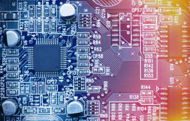 Printed circuit board with chips and other electronic components. Computer and networking communication technology concept. Toned image.