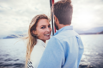 Loving young couple on a romantic boat trip
