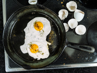 Frying eggs in a cast iron pan