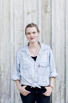 Portrait of young woman wearing denim shirt