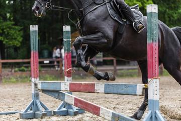 sportsman on horse overcomes barrier