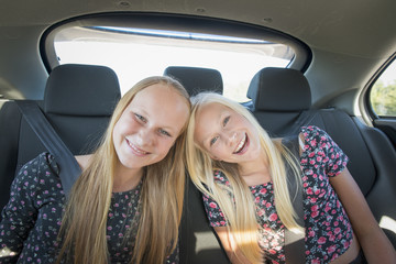 Portrait of teenage girls in car
