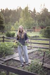 Teenage girl in garden