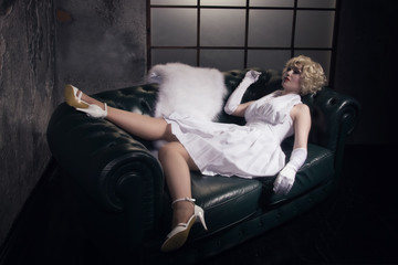 Beautiful woman with make-up skeleton lying on the sofa