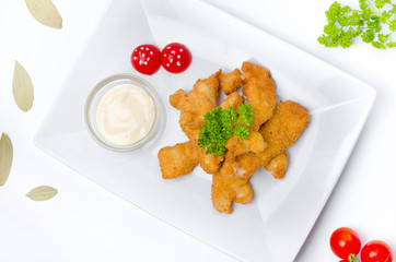 Nuggets with sauce on a plate