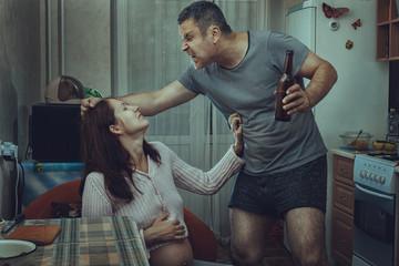 Alcoholic husband beats his wife.