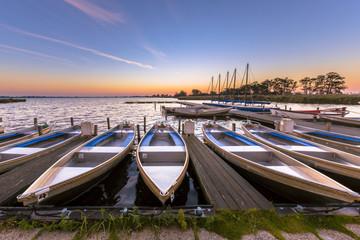 Wall Mural - Rental boats in a marina at sunrise