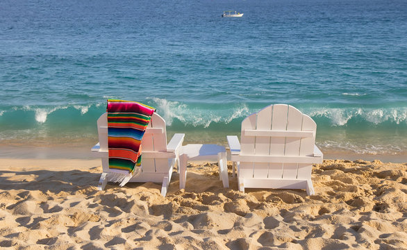 Two beach chairs near ocean