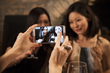 Women have taken a friend with smartphone
