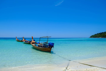 fishing boat against clear sea and blue sky