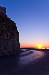 Taking unforgettable photos along the scenic coastal road of Rethymno bay at sunset, Crete, Greece