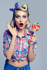 beautiful woman with lollipop, dressed in pin-up style