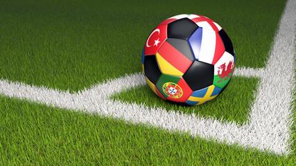 Bunter Fußball mit Nationalflaggen der Teams der EM 2016. Eckball auf grünem Rasen.