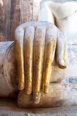 Close up ancient hand of buddha at Sukhothai Historical Park, Th