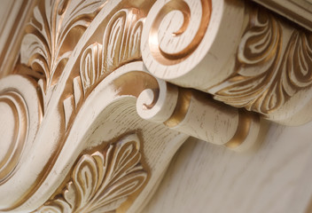 abstract background. carving element. furniture in classic style. white tree with gold trim. patina. carving. small depth of field. luxury furniture.
