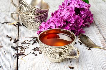 Wall Mural - Stylish metal cup of tea