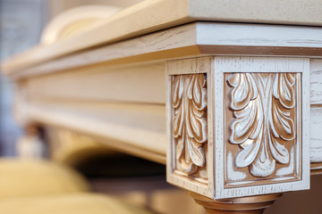 carving element. furniture in classic style.  furniture in classic style. white color wood with gold trim. patina.  carving. small depth of field. luxury furniture. use as background.
