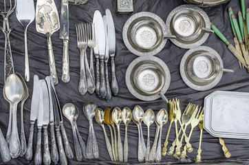collection of cutlery on a street market