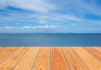 Empty wooden shelves with sea on background. For display product