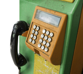 old and dirty coin telephone with clipping path