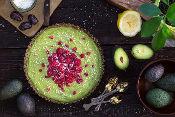 Raw Healthy Paleo Avocado Lemon Cake with Banana and Raspberries, Top View