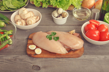 Chicken fillet with ingredients for cooking healthy meals