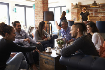 Group Of Friends Meeting For Coffee In Bar