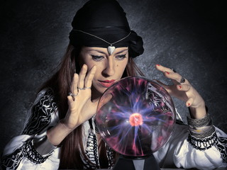 gypsy fortune teller forecasting future with crystal ball