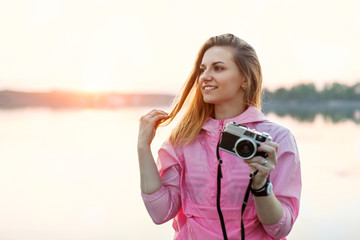 Hipster woman takes pictures outdoors