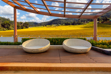Relax corner on condominium rooftop garden with chairs on Green Terraced Rice Field in Pa Pong Pieng at Chiang mai background, Relaxing concept
