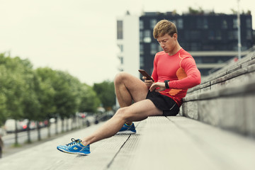 Jogger checking sport performance on his mobile phone