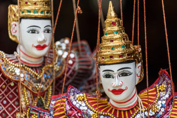 Asian dancer puppet dolls (selective focus on front doll's face only)
