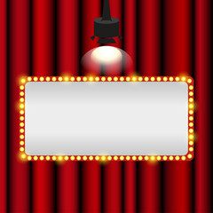 Vintage signboard with lights on a red background theatre