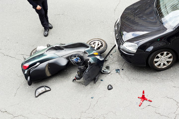 motorcycle , motorbike,  accident  with car in  city street
