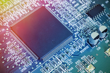 Printed circuit board with chips and other electronic components. Computer and networking communication technology concept. Toned image