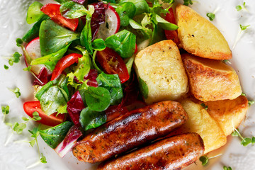 Roasted Sausages with Chips and Mix Vegetable salad