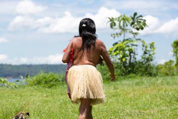 Amazon indian woman-hunter walking in the field near Manaus, Bra