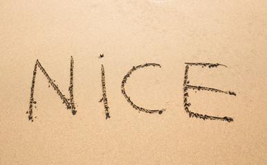 Nice Word Written On Sunny Summer Beach Sand