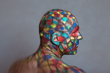 Superhero profile portrait, colorful body art with tilt shift and motion blur effect.