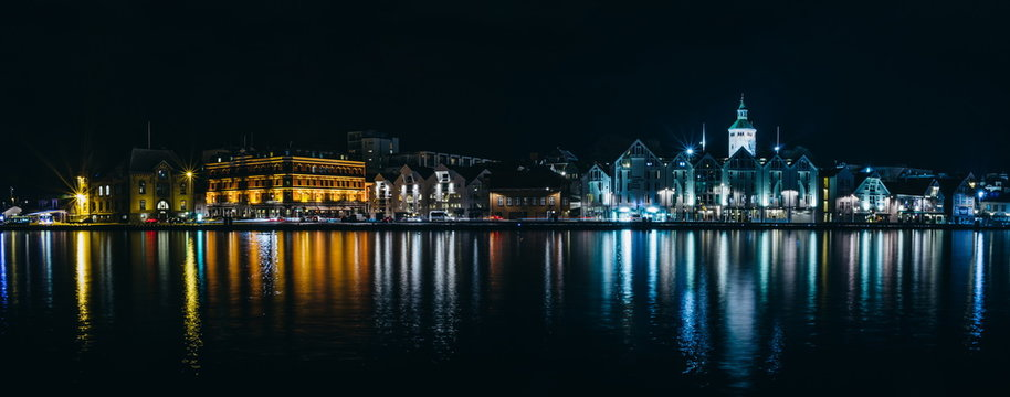 Beautiful night Stavanger cityscape with lights water reflection, Norway