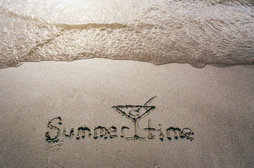 Summer time hand drawn lettering text and cocktail glass on sand. Sunburst vacation postcard template.