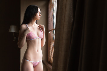 woman standing in lingerie