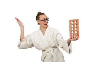 Funny woman in kimono with brick on white