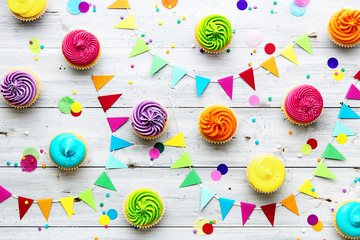 Wall Mural - Colorful cupcake party background