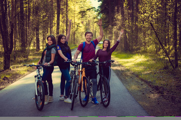 Group of adult having fun with bicycles.
