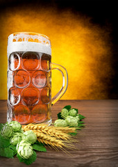 oktoberfest glass of beer with barley and hops - 3D render