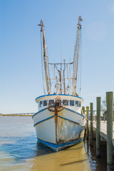 Shrimp boat tied to pier