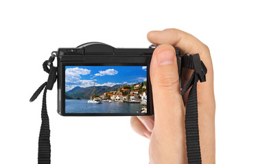 Hand with camera and Village Perast - Montenegro image (my photo